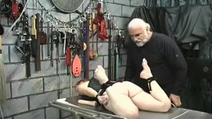Mature woman is gently rubbing her big tits, while her husband is watching her in action